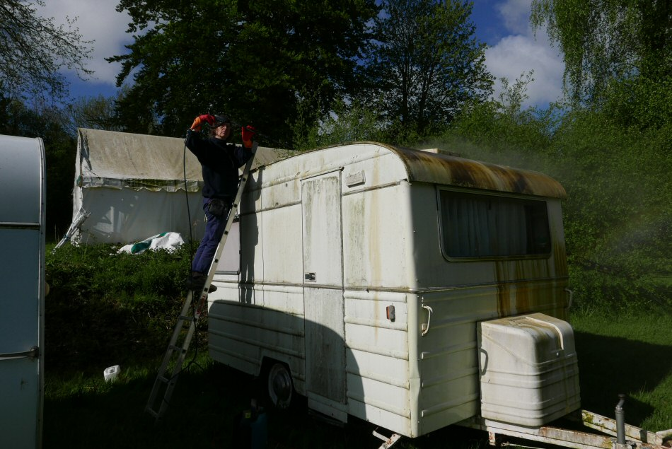 dirty old french caravan being cleaned