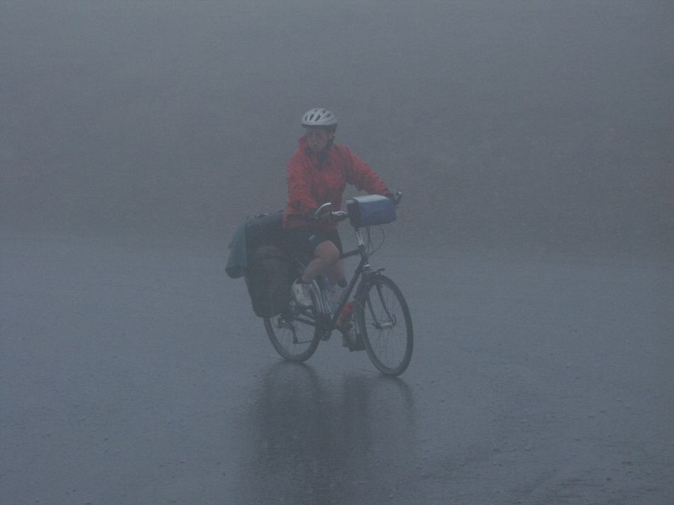 Evelyn cycles to the top of the Soulor in fog