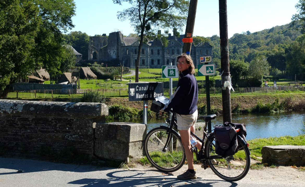 Kate cycling at the abbey at Bon Repos